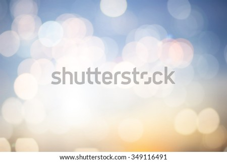 abstract blurred backgrounds of evening sky backdrop with circle lights in pastel tone colored.blur of bokeh bulbs:Christmas festive backdrop concept.blurry bubble glitter sparkle round.  - stock photo