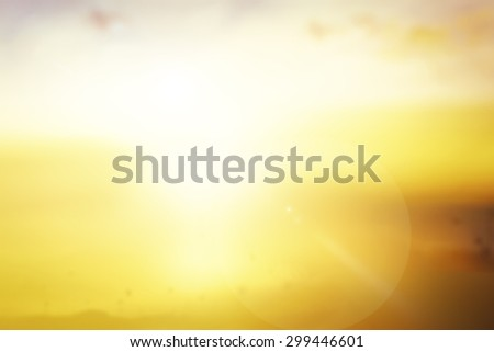 Abstract blurred beautiful flower garden on the top of mountain over golden amazing light sunset background. World Environment Day, Ecology, International Mountain Day, Spring Time concept. - stock photo