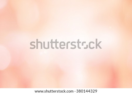 abstract blurred beautiful soft brightening pink background:blur old rose colorful backdrop with bokeh lucent light:beauty shiny wallpaper with lens flare light effect filter:vivid vintage tone image. - stock photo