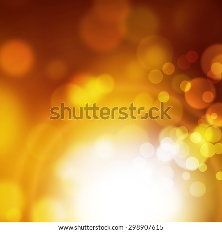 Abstract blurred bokeh background in yellow gold brown colors with white light effect - stock photo