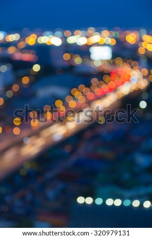 Abstract blurred bokeh city highway curved during busy hour - stock photo