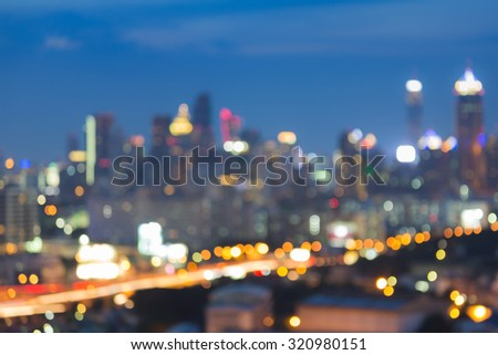 Abstract blurred bokeh city lights background at night - stock photo
