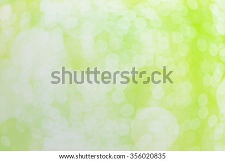 Abstract blurred bokeh green background from defocused shot - stock photo