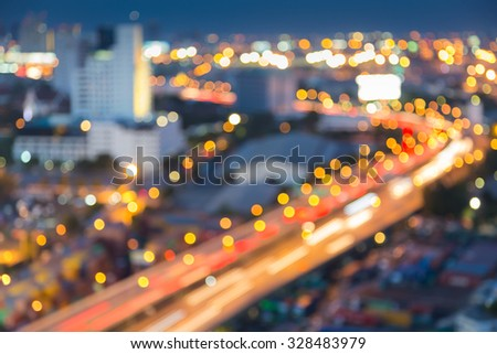 Abstract blurred bokeh light of city downtown highway curved at nigth - stock photo