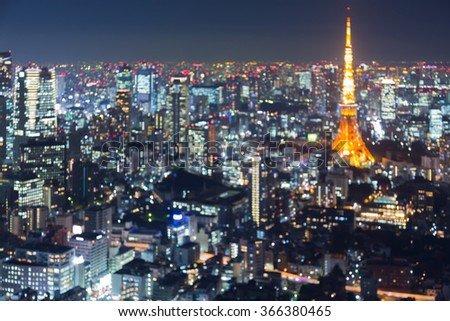 Abstract blurred bokeh light, Tokyo cityscape downtown aerial view at night - stock photo