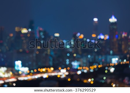 Abstract blurred bokeh lights big city downtown night view - stock photo