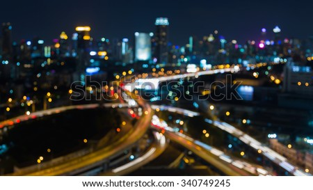 Abstract blurred bokeh lights, city night road intersection at night - stock photo