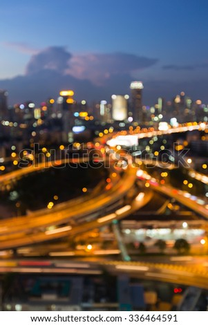 Abstract blurred bokeh lights, city road interchanged with city lights background - stock photo