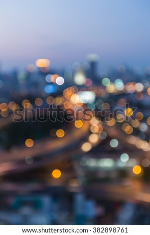 Abstract blurred bokeh lights during city with road interchanged during twilight - stock photo