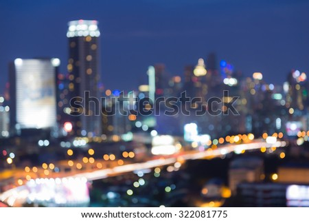 Abstract blurred bokeh lights, highway front with city background - stock photo