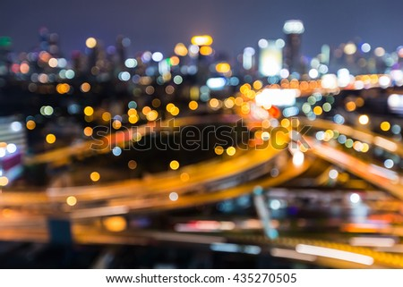 Abstract blurred bokeh lights, Highway intersection and city business downtown background at night - stock photo