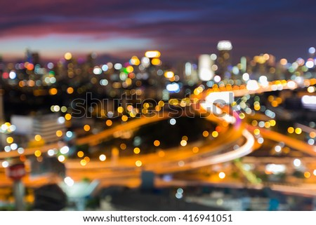 Abstract blurred bokeh lights, highway intersection and city downtown background - stock photo