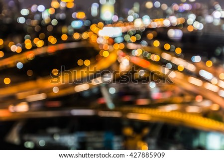 Abstract blurred bokeh lights, highway intersection close up  - stock photo