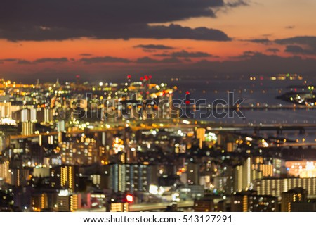 Abstract blurred bokeh lights Osaka city downtown with sunset sky background