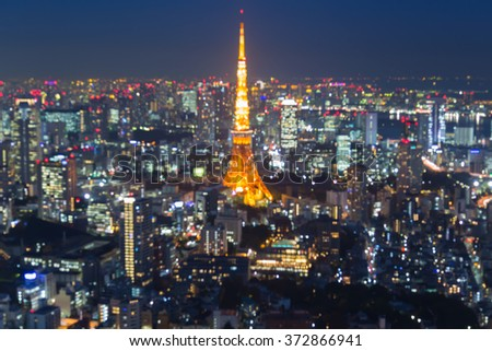 Abstract blurred bokeh lights Tokyo city downtown aerial view night time - stock photo
