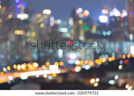 Abstract blurred bokeh multiple colour lights city background - stock photo