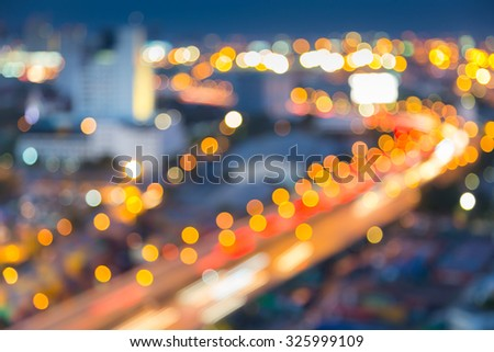 Abstract blurred bokeh of Bangkok city highway curved during twilight, Thailand - stock photo