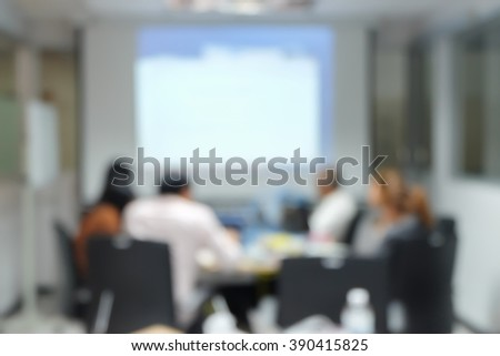 abstract blurred business people brainstorm about new assignment project at meeting room:blue employee of art and advertisement company thoughtful/discussion together for make a good job:blur people. - stock photo