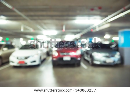 Abstract blurred car in parking background - stock photo