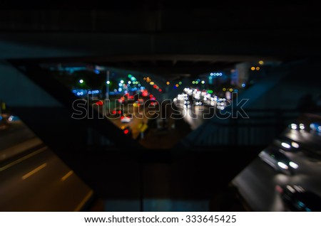 Abstract blurred car traffic in evening light. - stock photo