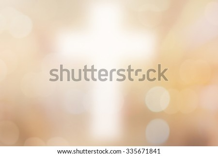 abstract blurred christ cross over gold color background with bokeh circle lights:blur religious backdrop concept:blurry power of religion conceptual. - stock photo