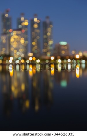 Abstract blurred city lights background with water reflection - stock photo