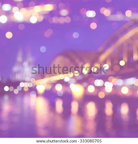 Abstract blurred city lights with bokeh in Cologne. Germany. - stock photo