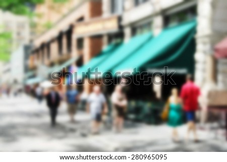 Abstract blurred city sidewalk with shops and cafes in the summertime - stock photo