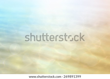 Abstract Blurred colorful clear sea water reflecting in the sun over beautiful sunset background. - stock photo