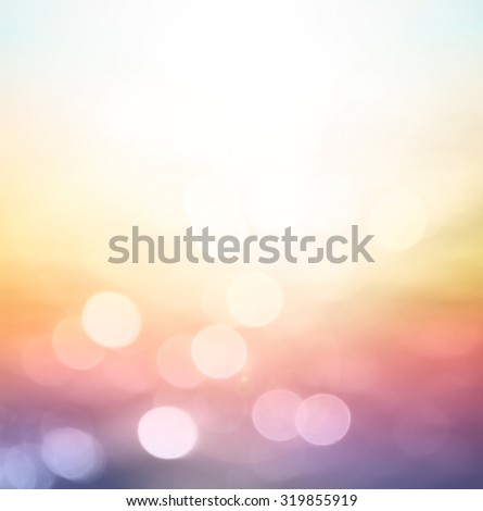 Abstract blurred colorful rainbow textured background: yellow red pink purple violet patterns. Sandy beach backdrop with turquoise water and bright sun light. Happy Valentine's Day, Love, Fun concept. - stock photo
