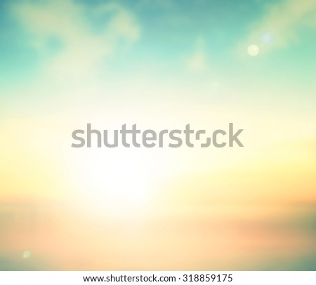 Abstract blurred colorful textured background: yellow orange and blue patterns. Sandy beach backdrop with turquoise water and bright sun light.  - stock photo