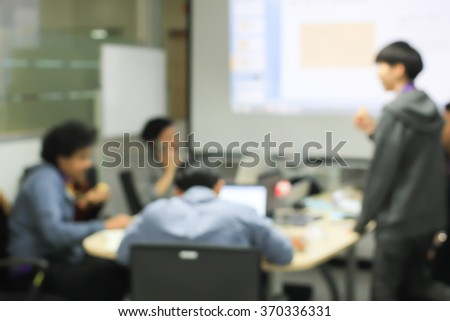 abstract blurred creative men brainstorming about new assignment project at meeting room:blur employee of art and advertisement company thoughtful/discussion together for make a good job:blur people. - stock photo