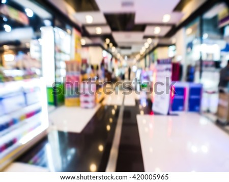 abstract blurred electronic shop in the mall department store super center. - stock photo