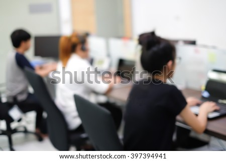 abstract blurred employee working/researching data information in office room:blur group of teamwork asian people using laptop/notebook/computer technology concept:collaboration:network engineering - stock photo