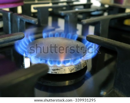 Abstract blurred gas burning from a kitchen gas stove. Great background.                                - stock photo