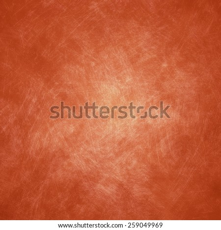 abstract blurred geometric pattern copper orange background with shabby distressed vintage background texture and soft center lighting for text - stock photo