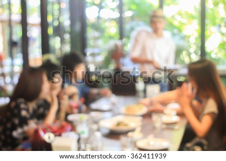 abstract blurred group of asian women meeting in the restaurant background:blurry of caucasian people having funny party after working concept:blur lifestyle manner conceptual.friendship conception. - stock photo