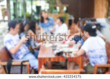 abstract blurred group of asian women meeting in the restaurant background:blurry of caucasian people having party after working concept:blur display image conception.