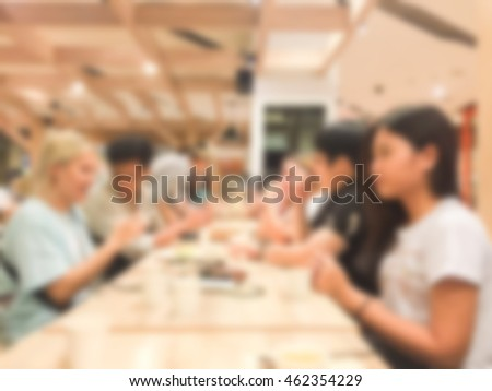 abstract blurred group of asian women meeting in the restaurant background:blurry of caucasian people having funny party after working concept:blur lifestyle manner conceptual.friendship conception.