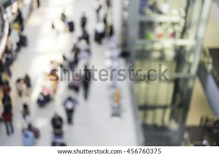 Abstract blurred image of people in the air port for background. - stock photo