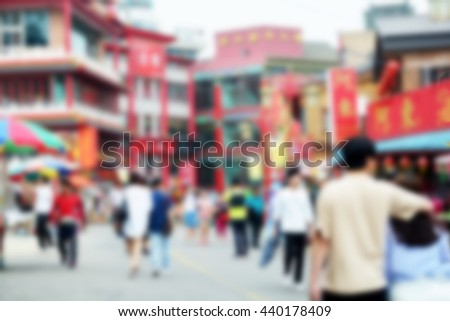 Abstract blurred image of people walking on the street in china town - stock photo