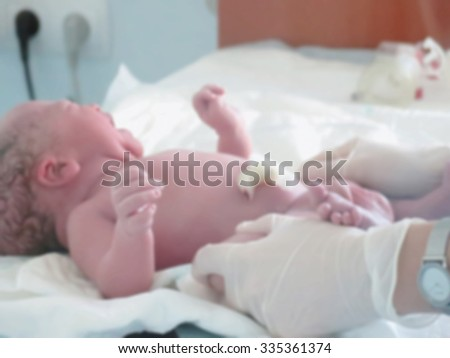 Abstract blurred image of the interior box for newborns pediatricians and the newborn child with