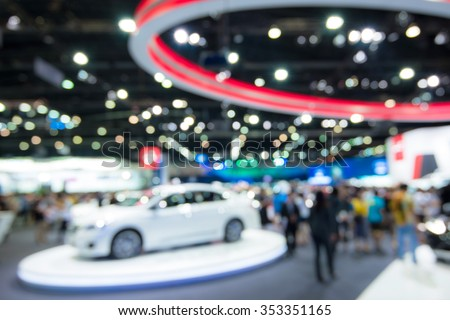 Abstract blurred image people in cars exhibition show