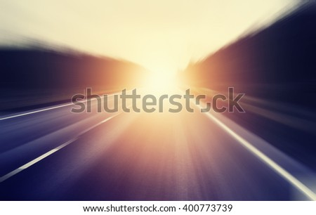 abstract blurred image, sunrise on an empty road - stock photo