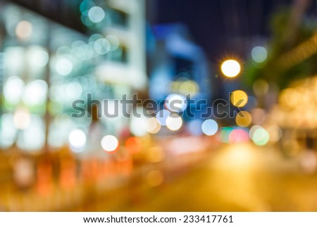 Abstract blurred light and building in shopping street - stock photo
