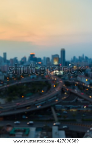 Abstract blurred lights city downtown background and highway interchanged early sunset sky  - stock photo