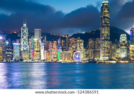 Abstract blurred lights Hong Kong business building with Victory bay front