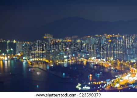 Abstract blurred lights Hong Kong city over Victoria bay, night view