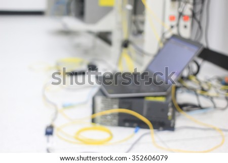 abstract blurred of computer working test link network system at data center:blur technology background concept:blurred telecommunication engineering connectivity laboratory.conceptual. - stock photo