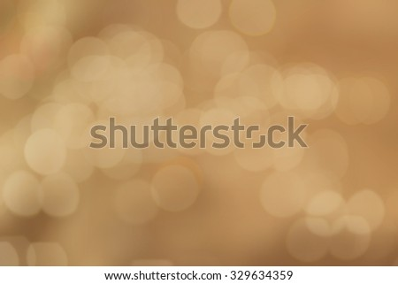 abstract blurred of golden colour backgrounds with circle lights.blur of bokeh circle light christmas festive backdrop concept:blur gold yellow backdrop concept. - stock photo